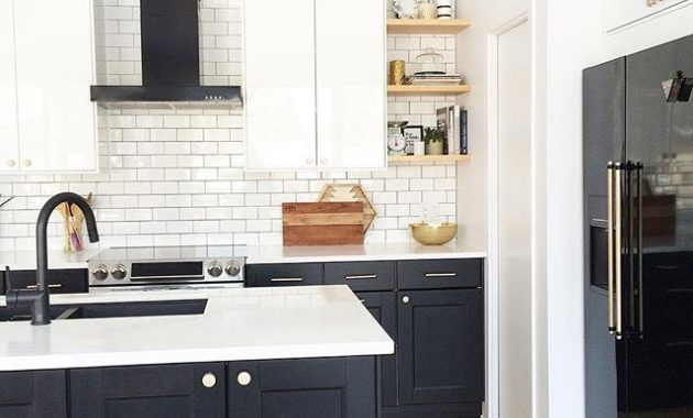 Exclusive Ambience Kitchen with Black Appliances