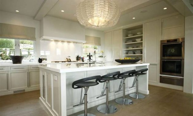 Crystal Chandelier Over Kitchen Island To Add Luxury To Your Kitchen