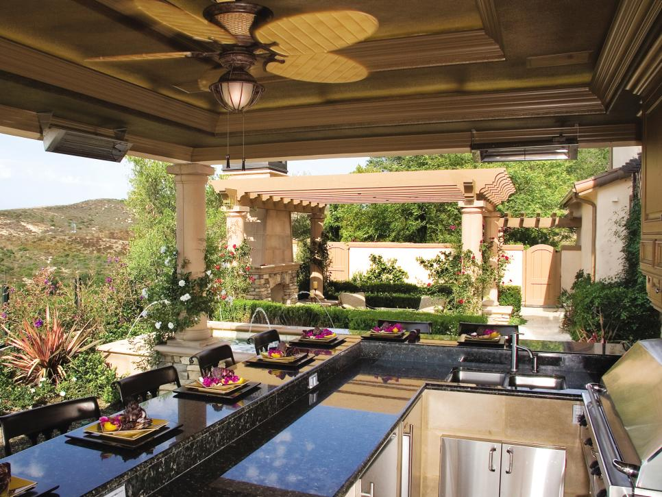 Superior Cooking And Entertaining People In An Open Space Kitchen. Outdoor Kitchen  Patio Ideas