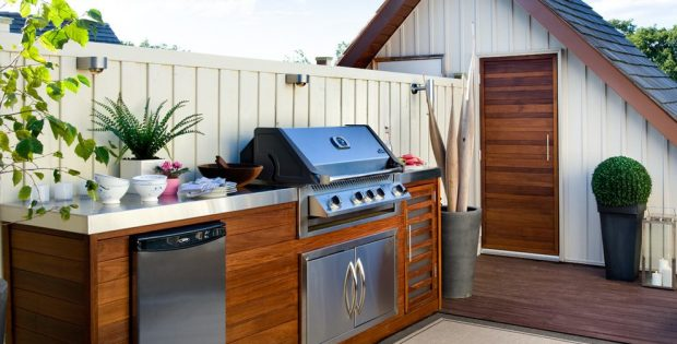 rooftop kitchen with a grill