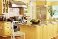The Muted Yellow kitchen with granite countertops