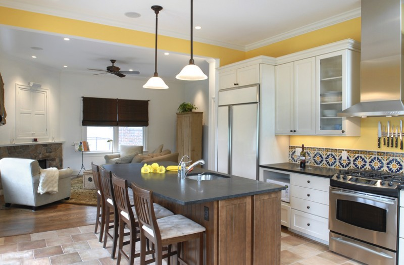 white island and yellow tile backsplash