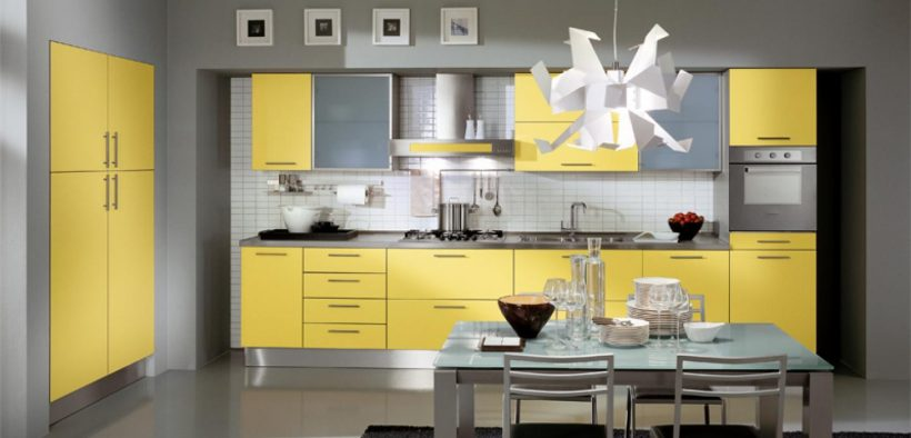 yellow cabinetry and grey walls