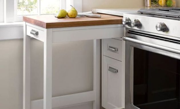 kitchen-remodeling-ideas-metal-table-fruits-countertop-glass-window-floor-white-cabinets