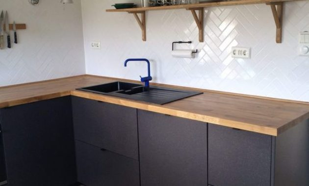 used-kitchen-cabinets-radio-glasses-knife-knives-countertop-switch-light-wooden-floor-faucet