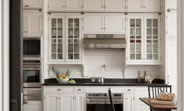 country-kitchen -white-kitchen-set-cabinet-classic-ceiling-light-wooden-floor-countertop-kitchen-wooden-chair